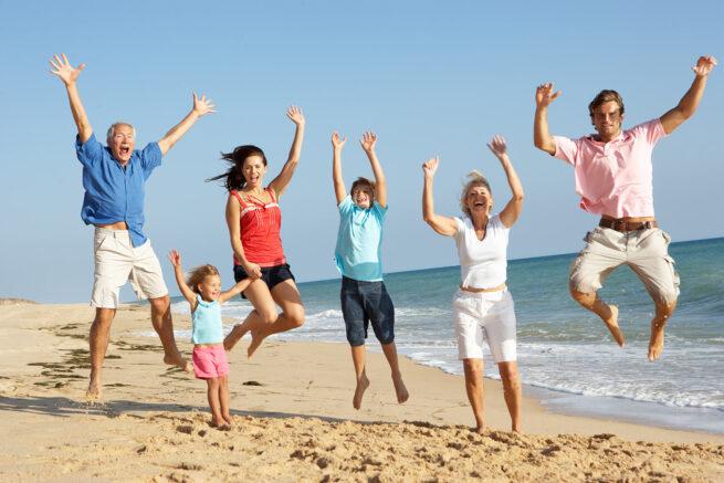 Family-jumping-coastal-beach